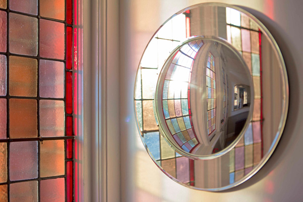 Madeira Road, hallway reflection through a curved convex mirror