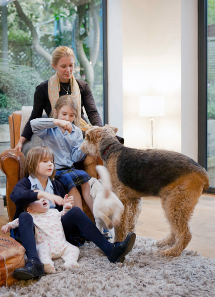 family portrait with dogs with interior setting