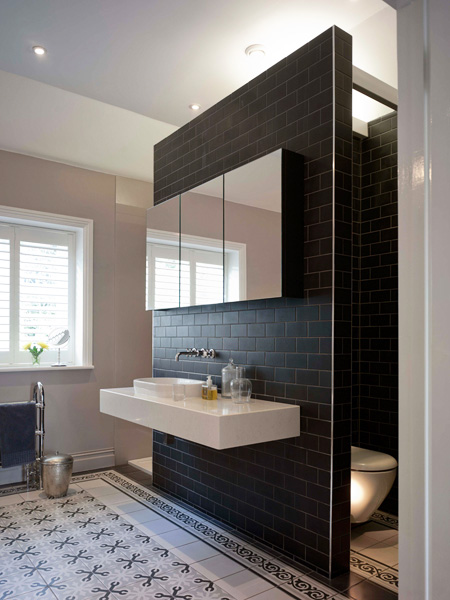 bathroom with dividing wall and suspended sanitaryware