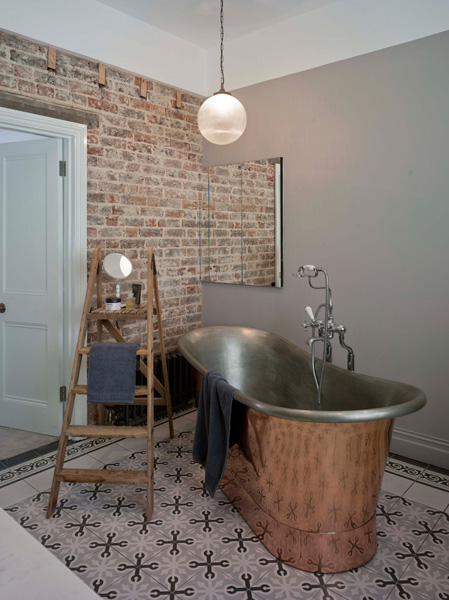 Madeira Road, bathroom unsuite with freestanding copper bath and tiled floor and brick walls