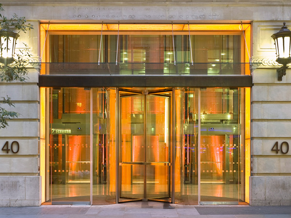 Argyll Street, entrance glazed revolving doors withorange coloured lights