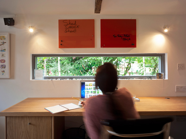 Garden Office / Gallery / Den internal joinery detail / desk and window with person