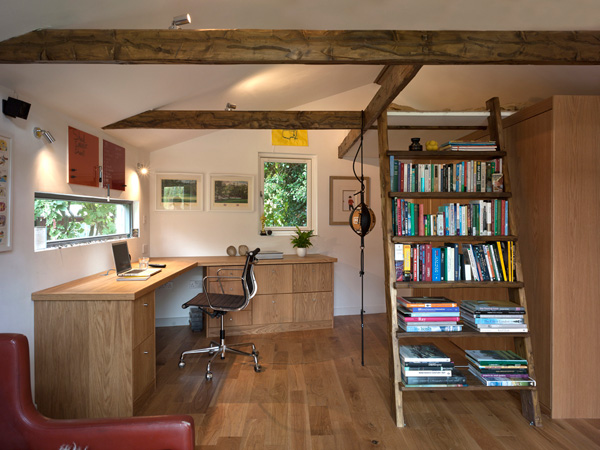 Garden Office / Gallery / Den internal view showing joinery, timber structure, furniture and artwork