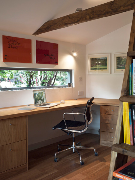 Garden Office / Gallery / Den internal perspective showing office area, library / stairs, artwork, eames chair