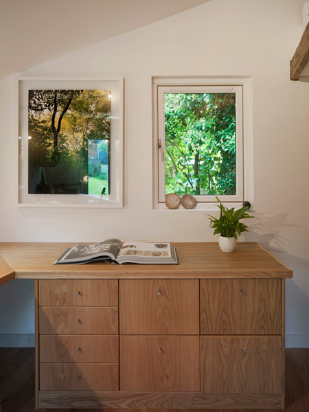Garden Office / Gallery / Den internal detail with built in joinery, window and artwork