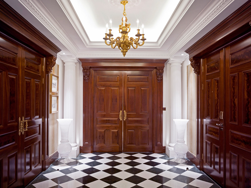 The Savoy, Royal Suite Entrance lobbywith chequered floor tiles with mahogany timber doots and specialist plaster work