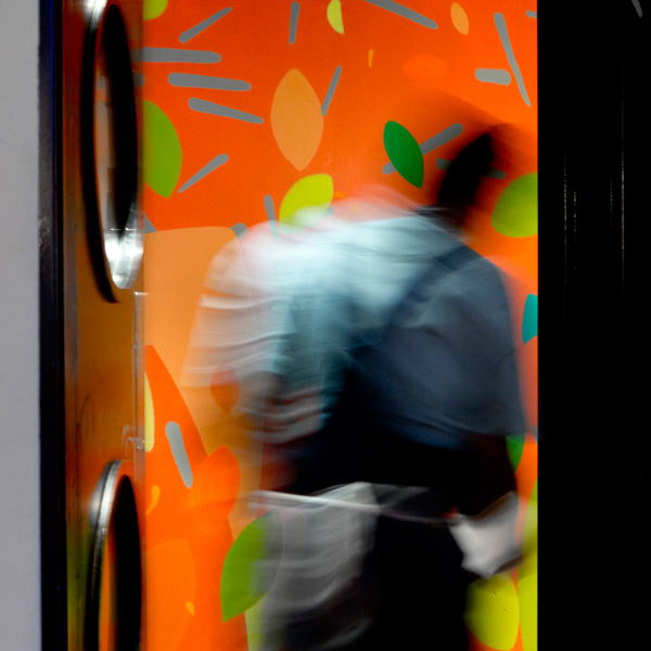 Tootoomoo restaurantdoor to kitchen with painted walls and person